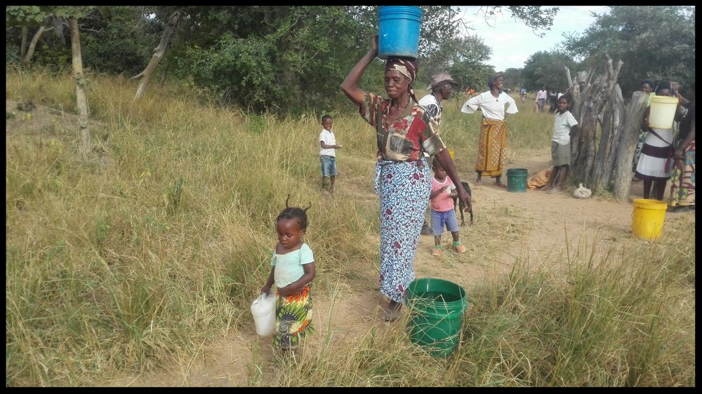 Happy Sibalwa villagers collect water from their new well. This well was built in the fall of 2016. The funds for these wells were provided by our wonderful donors in our Zambia 2016 campaign!