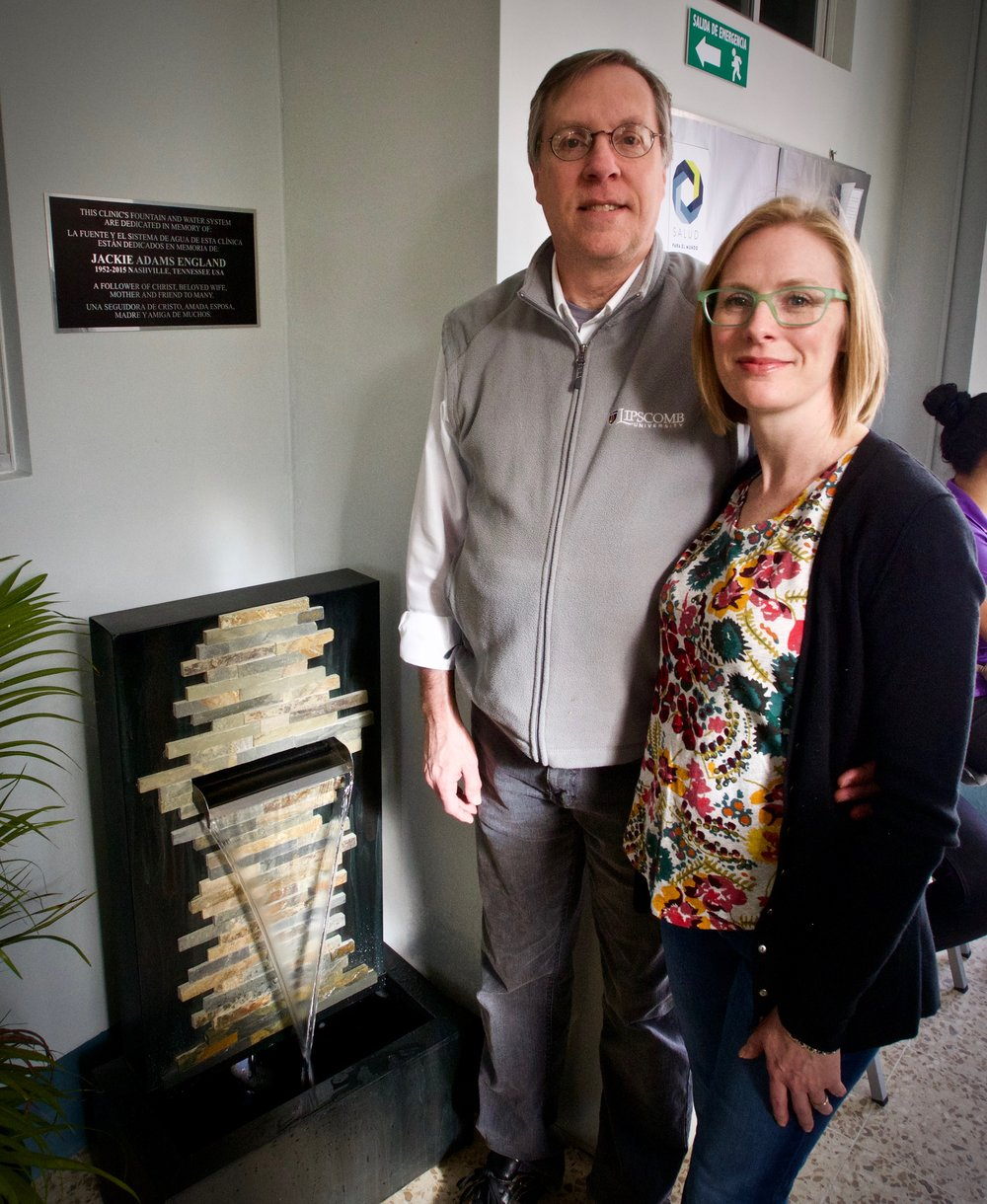 David England and Melody Gurley, Jackie England's husband and daughter, next to the plaque and water feature in Jackie's memory, placed in the clinic waiting area.