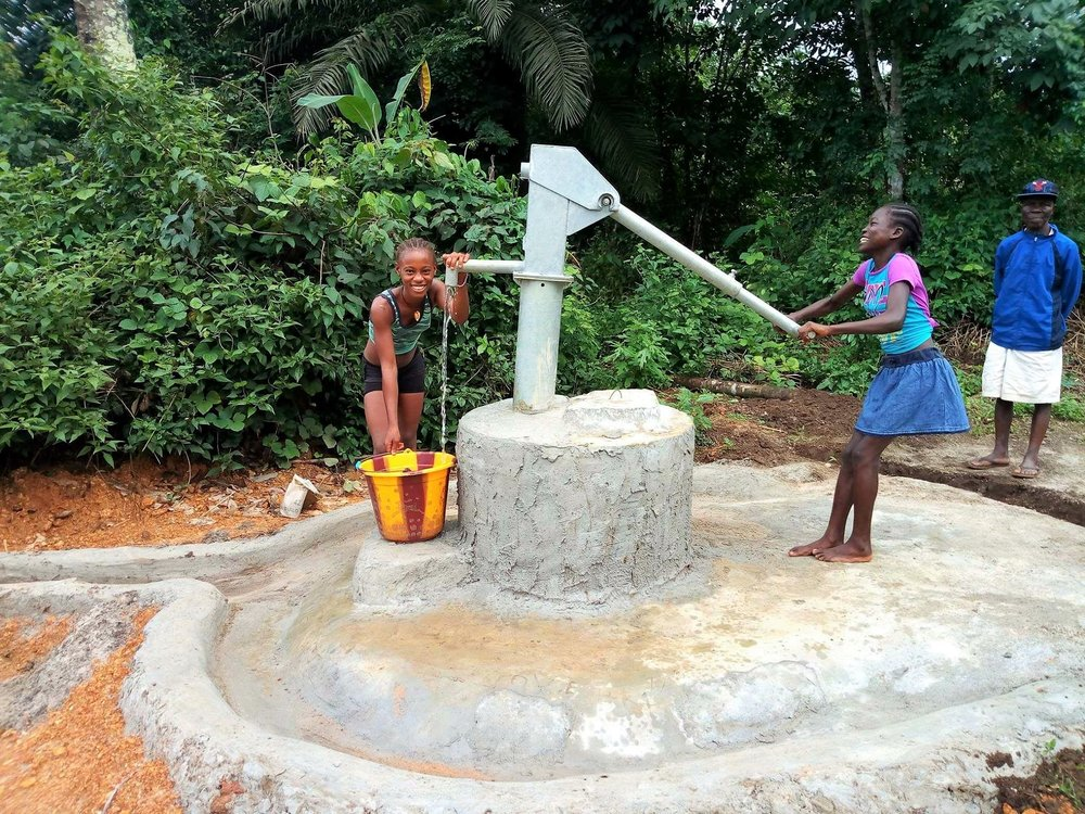 Happy children rejoice in their new well. Partners like Alfred Beyan advocate for to TLWP for their communities in need of clean water.