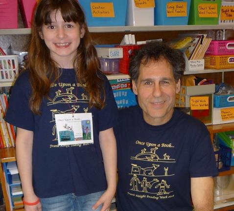 Posing with second grader who designed the back of T-Shirt!