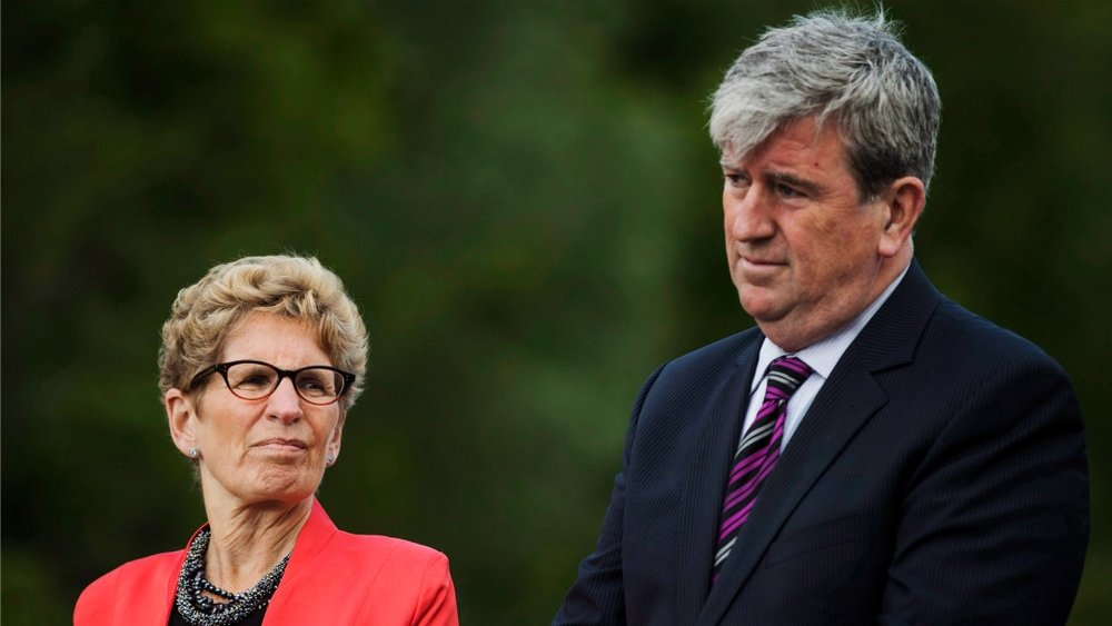 COP 22 will be less fanfare and more substance than the headline-grabbing Paris agreement, says Ontario Minister of Environment and Climate Change Glen Murray, pictured here with Kathleen Wynne. (Mark Blinch/Canadian Press)
