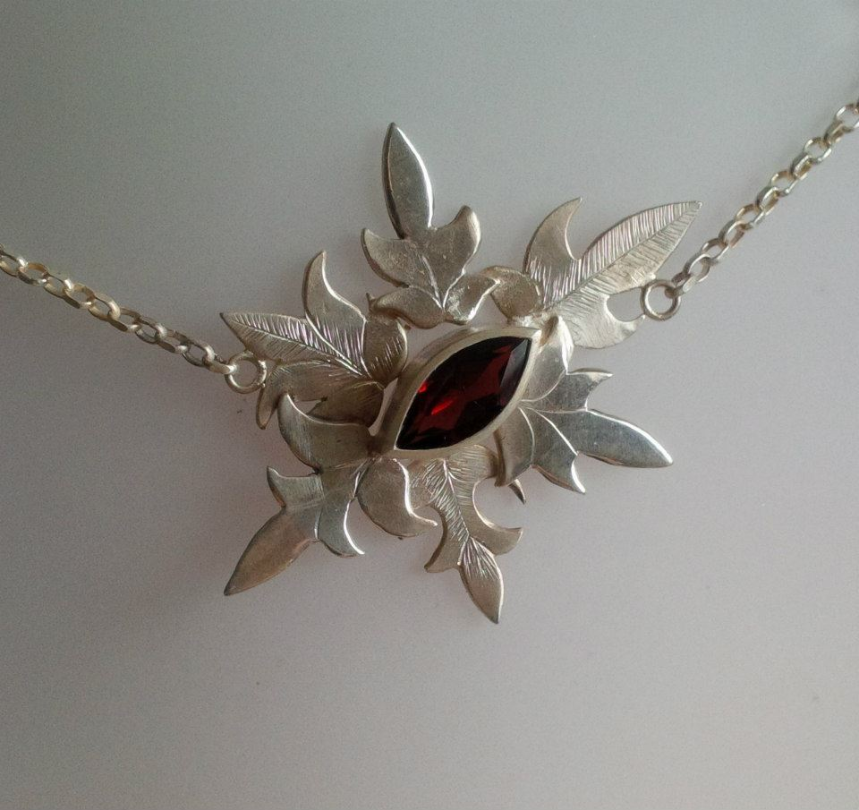 Silver necklace with hand engraved detail and a central, marquise cut garnet -  BUY