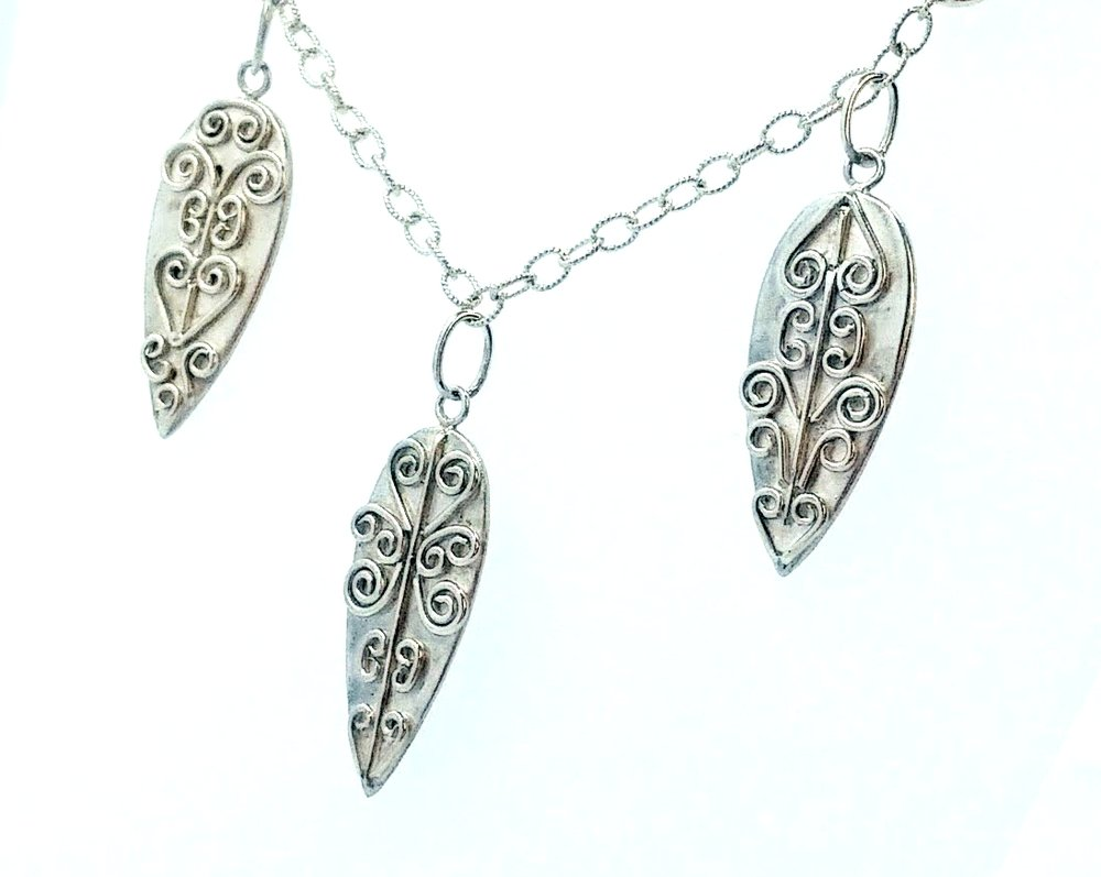 Silver necklace with three dangling pieces and wirework detail -  BUY