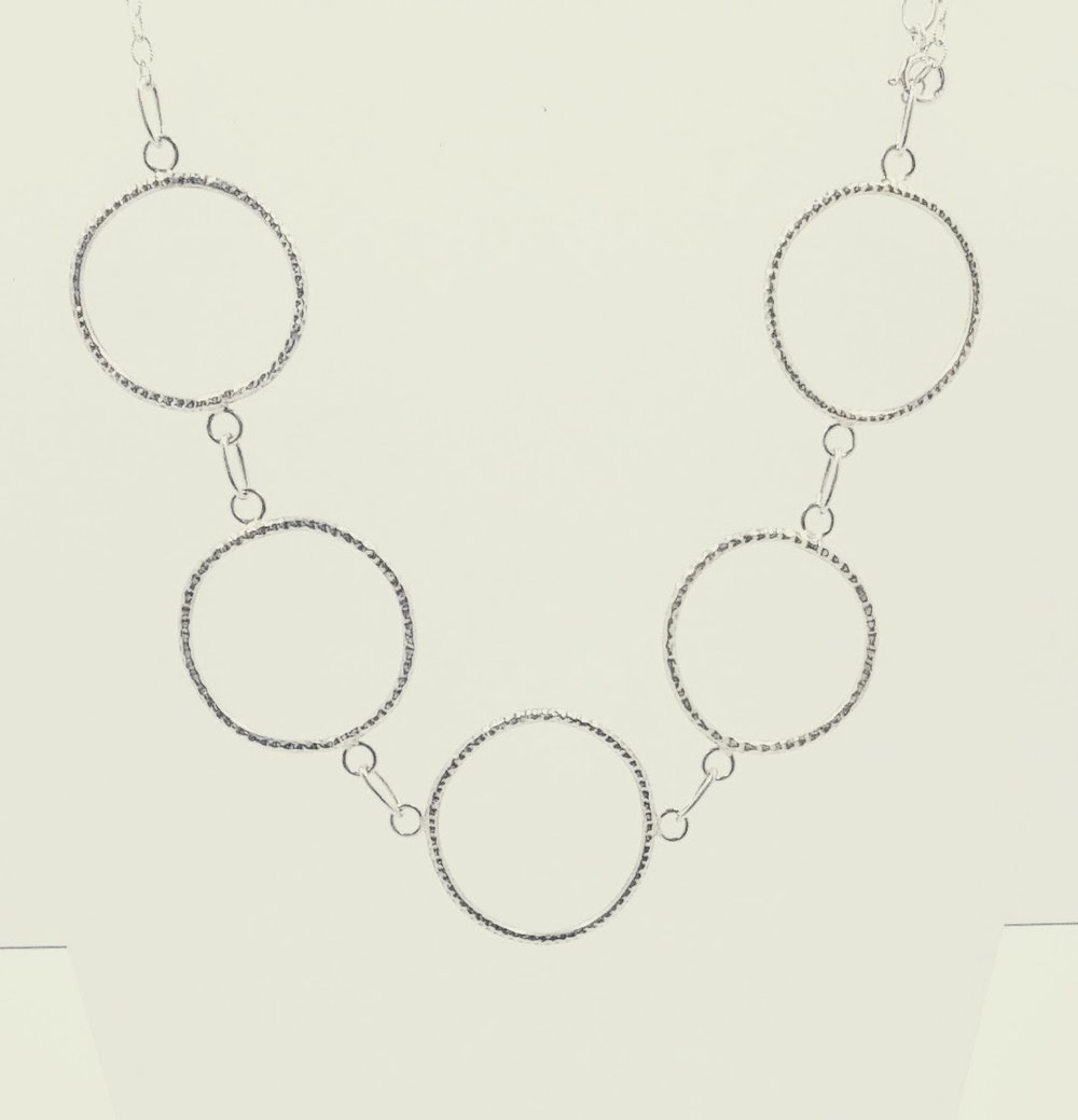 Large, silver necklace with textured, organic circles -  BUY
