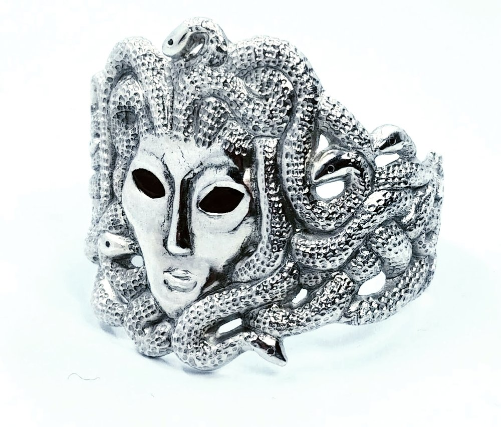 Medusa cuff with garnet eyes and 13 black diamonds as snake eyes