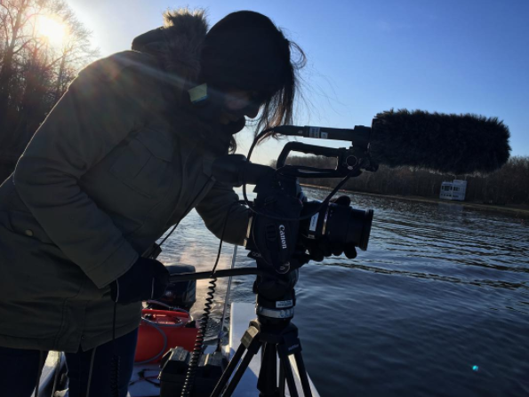 Filming on the back of a boat - Photo credit: Julia Lull