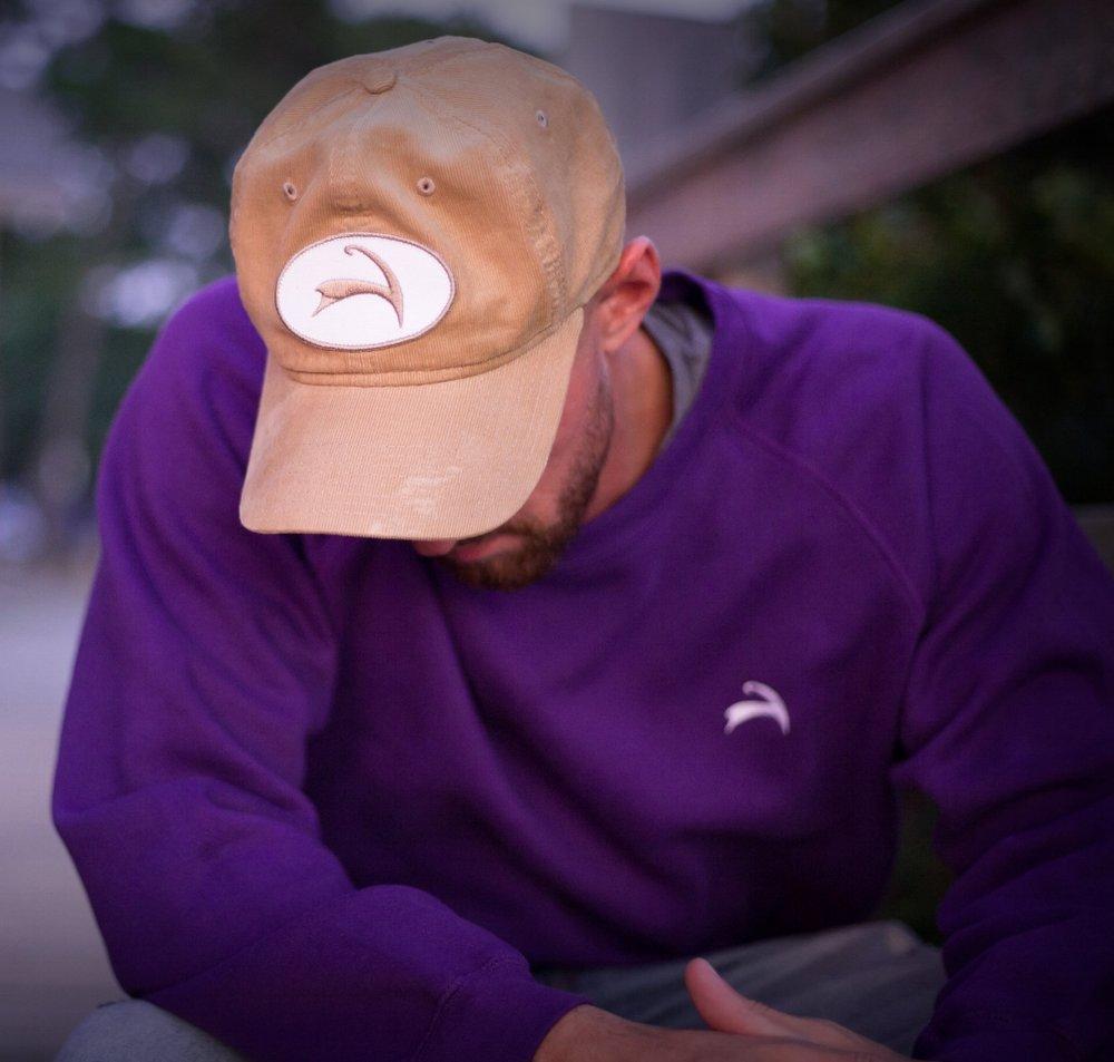 Corduroy Hat in Sand. Crewneck Sweatshirt in Purple.