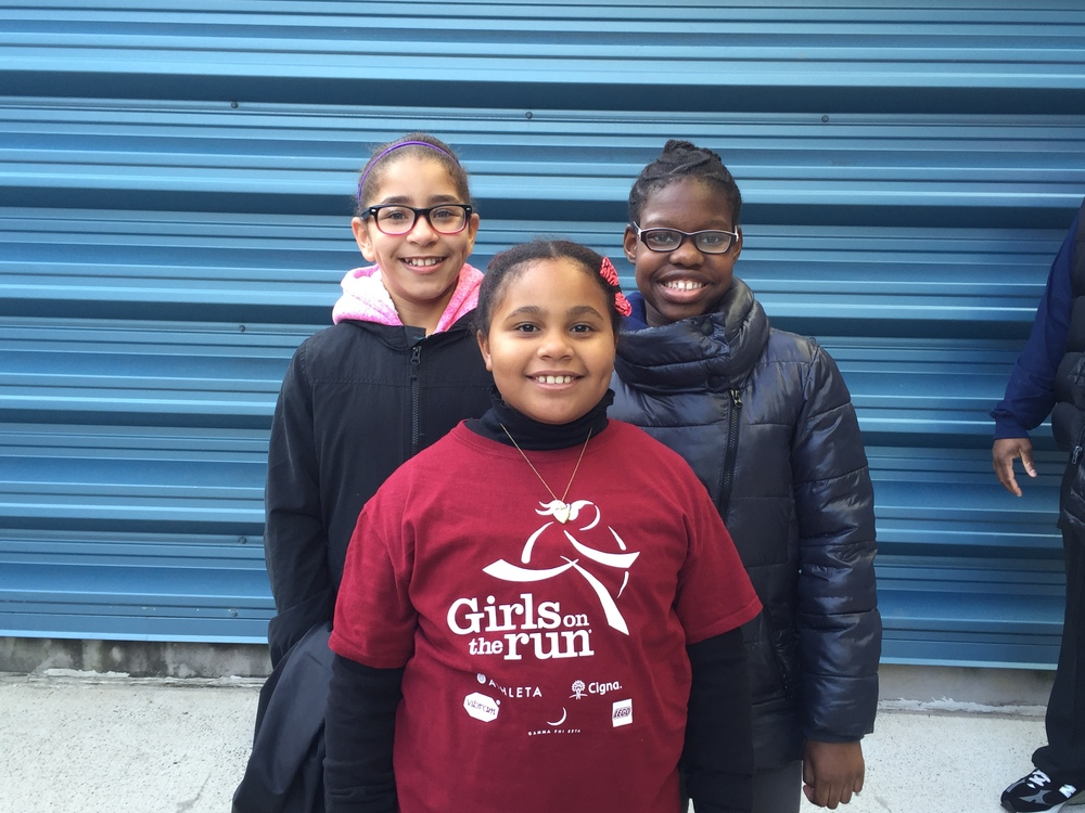 "Karauga-nea, Chloe, and Kymani ""I like running with GOTR because it gives me a lot of exercise and because I can run with my friends."" ""It's more healthy and I get to be with my friends."" ""We can support others and wish them good luck with their running."""