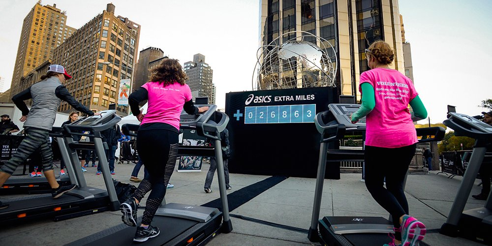 Girls on the Run team members take to the treadmills on Friday morning in Columbus Circle to be the first to run an #ExtraMile to support Girls on the Run! For every mile on the treadmill, ASICS donated a pair of shoes to GOTR.