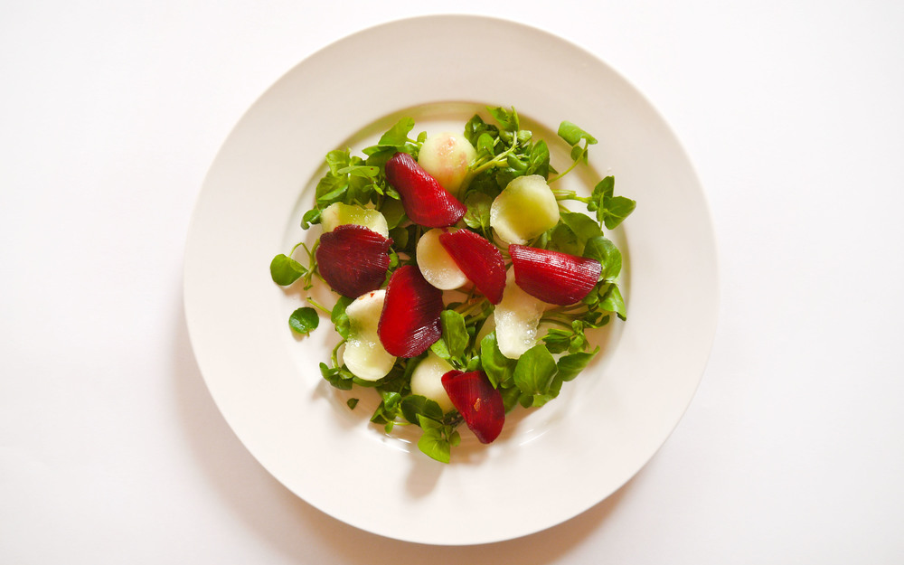 1. Arrange leaves as the base for the salad (watercress), then plate heavier salad elements first (melon and beetroot)