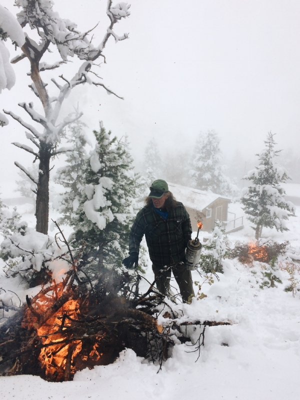 Camp manager Greg Creasy taking advantage of snowfall to help prepare camp for summer 2017.