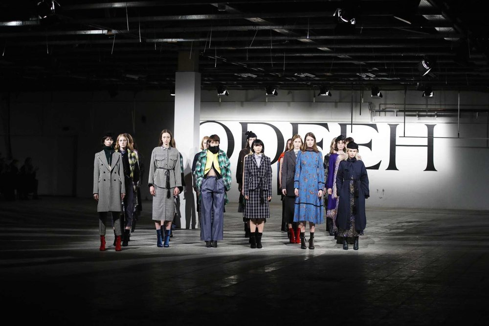 ODEEH   With their label ODEEH, the design duo Otto Drögsler and Jörg Ehrlich revisit old school couture.  Venture out into the new world with this season's must have: shaggy, boiled wool plaid jackets that are brave and instinctual. Bold color, these jackets are sometimes casual, sometimes elegant, sometimes both. They foster a tension between traditional and experimental tailoring as through their journey to perfection only specialists from the old world and new work on ODEEH -- the best traditional weavers and silk printers of northern Italy, through to the cutting edge production in modern German studios, everyone at every stage contributes to these masterful executions.