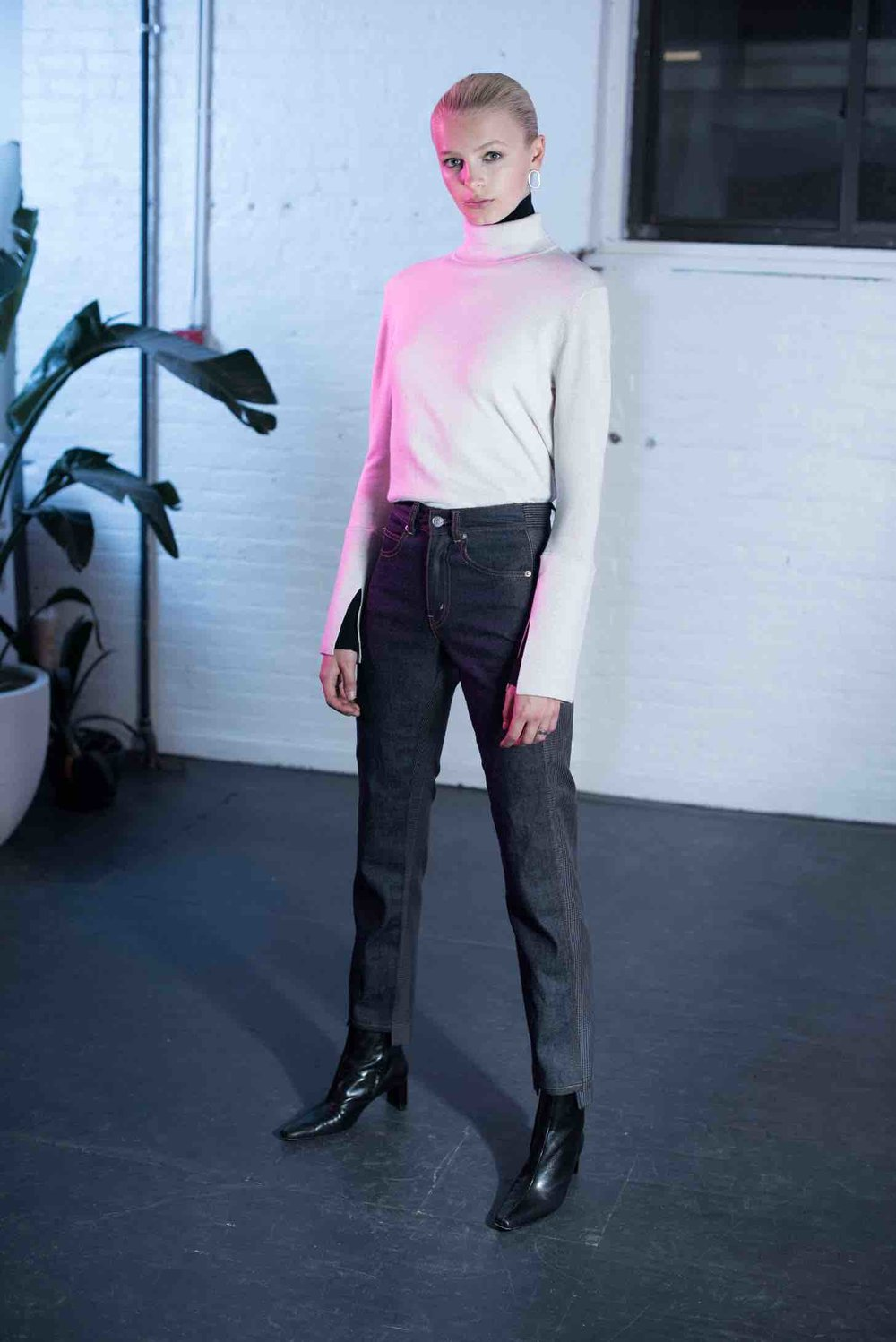 "SAYAKA DAVIS  The central idea behind Sakaya's sophistication is its roots in minimalist art, the concept of ""spacious beauty."" This concept allows for blank space to help define the clean, modern silhouette found in all of her finely crafted work. One of my favorites is the double layer turtleneck in Kelly green with white, black, and a black with white combination."
