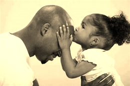 girl kissing dad 2.jpg
