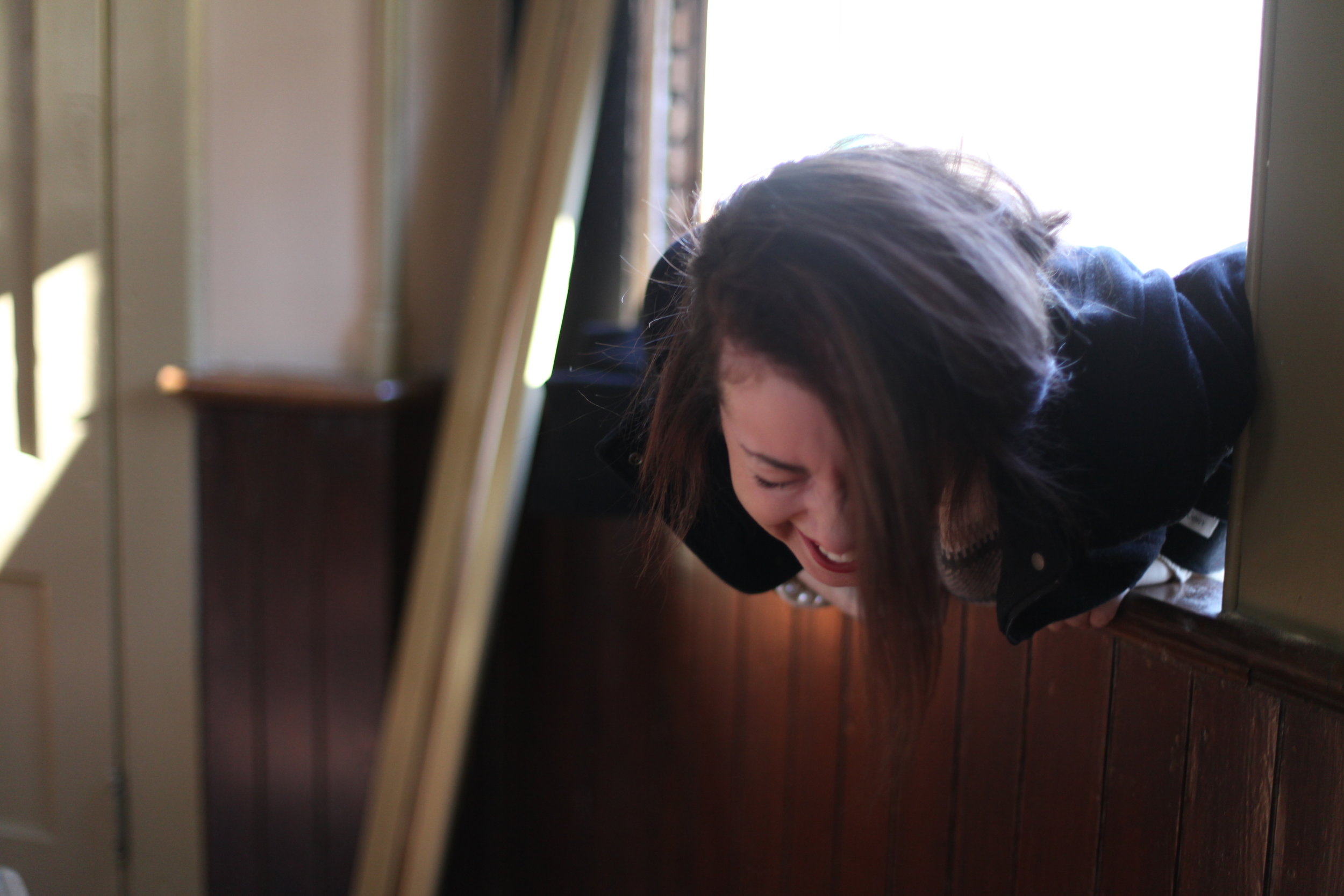 This is me falling through a window while breaking + entering on the day my hands were photographed by that typewriter.