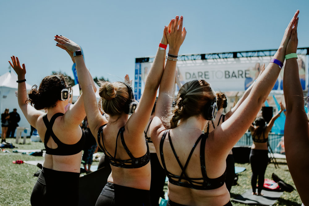 CHALLENGE YOUR INSECURITIES. OWN YOUR BODY. - Leave your insecurities behind and take ownership of the new confident, radiant you. During this day of sweat and support, participants are encouraged to wear our token of confidence - the We Dare to Bare sports bra - so they can celebrate their body exactly as it is and learn to love it unconditionally.