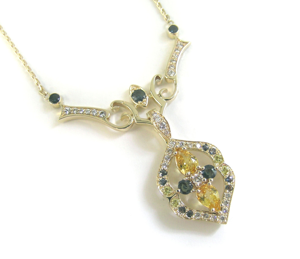unheated yellow sapphires and natural alexandrite with yellow diamonds in custom enhancer and necklace, design by Kelly McCaughey
