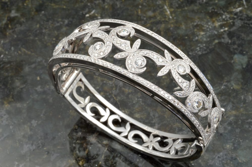 custom designed bangle bracelet set with fine diamonds in a swirl and leaf pattern, designed by Jason Baskin.