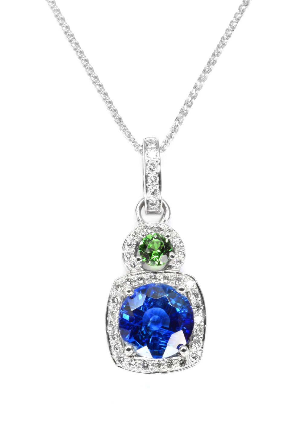 14k white gold pendant set with a rich blue kyanite and a bright green tsavorite accented with diamonds, designed by Jason Baskin.
