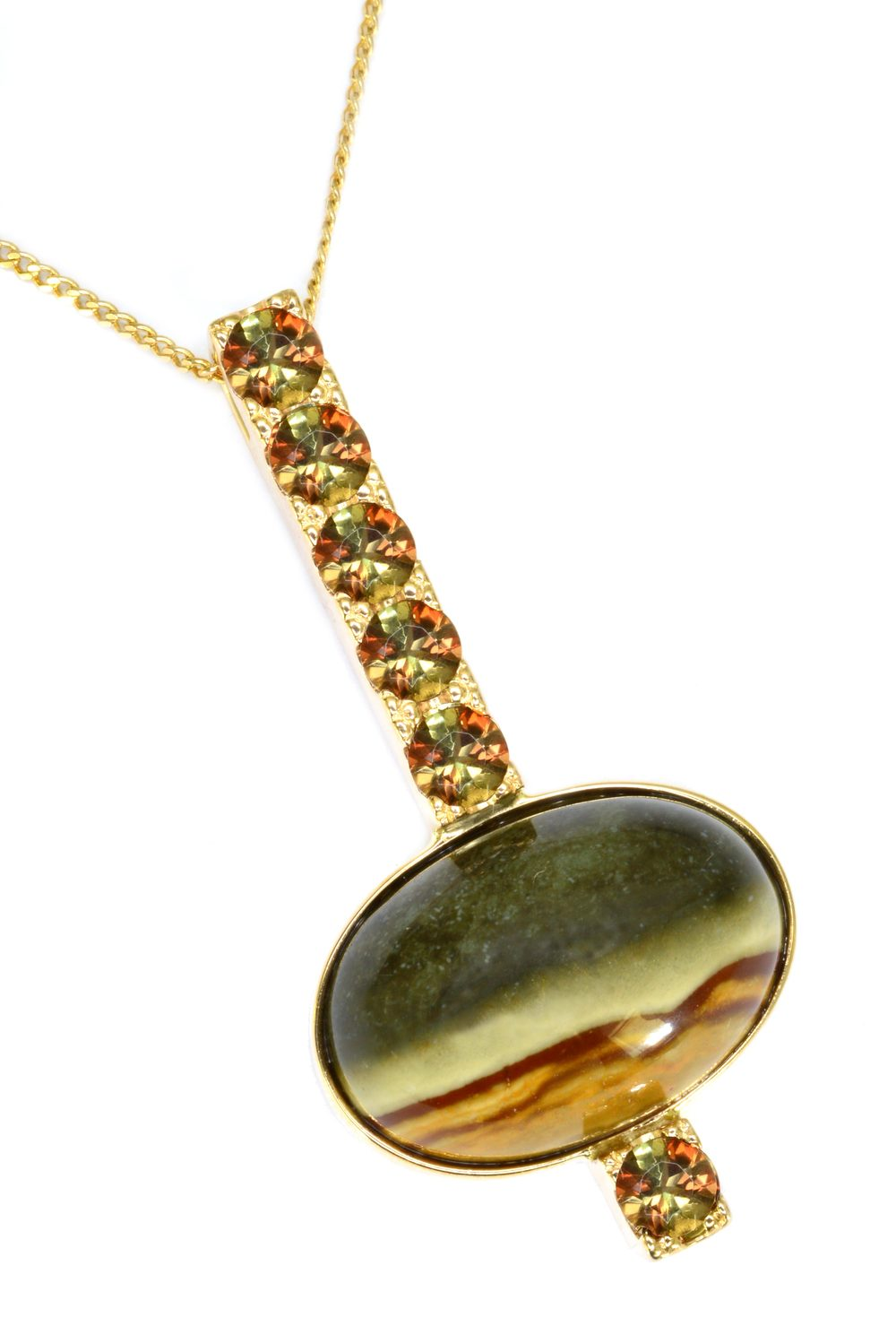 14k yellow gold pendant set with an oval picture jasper, accented by a row of finely matched andalusites, designed by Sharon Curtiss-Gal.
