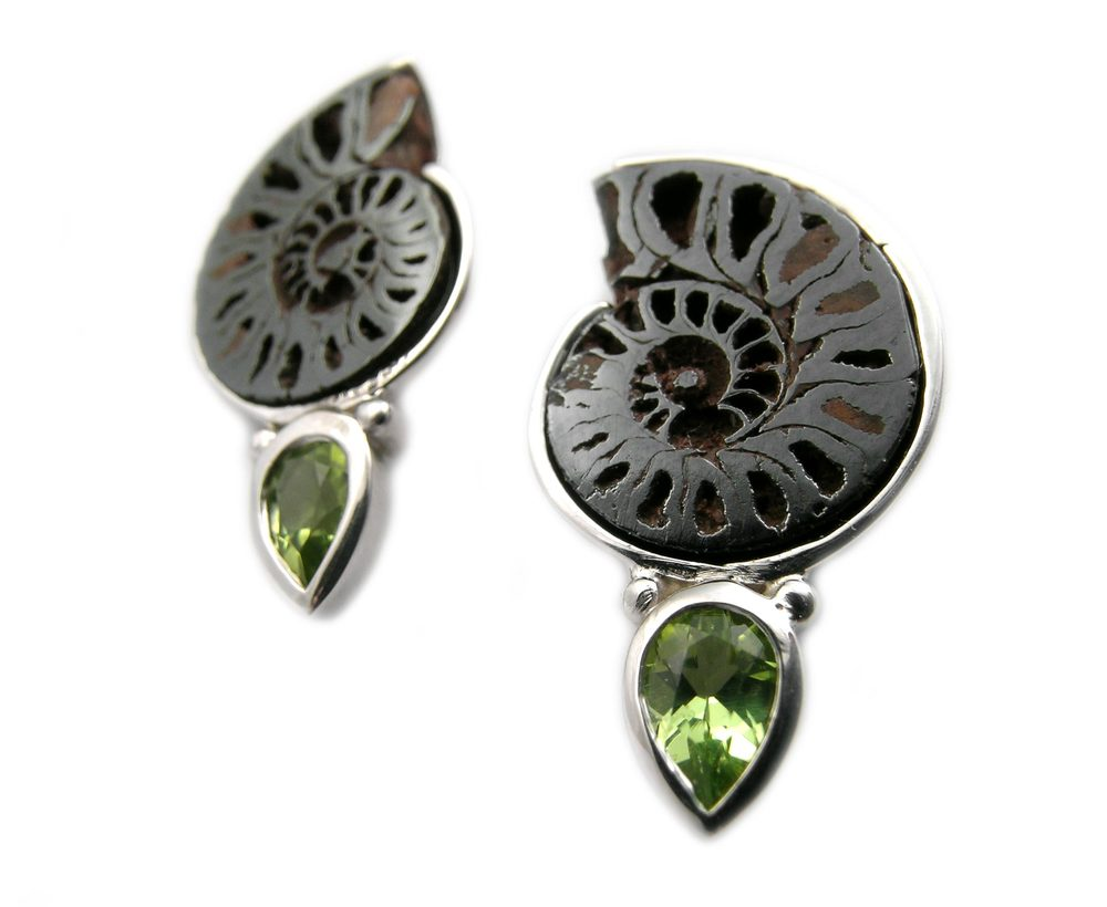 unique custom designed sterling silver earrings set with a pair of fossilized ammonites and pear shaped peridots, designed by Jason Baskin.