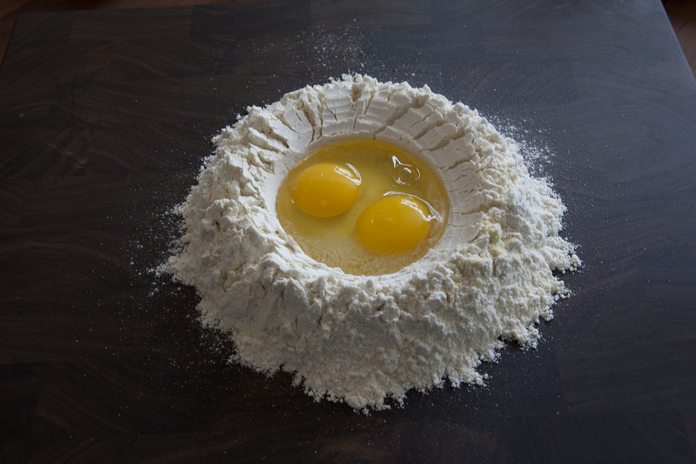 Start with your flour, eggs, water and oil. On the counter or in a bowl.