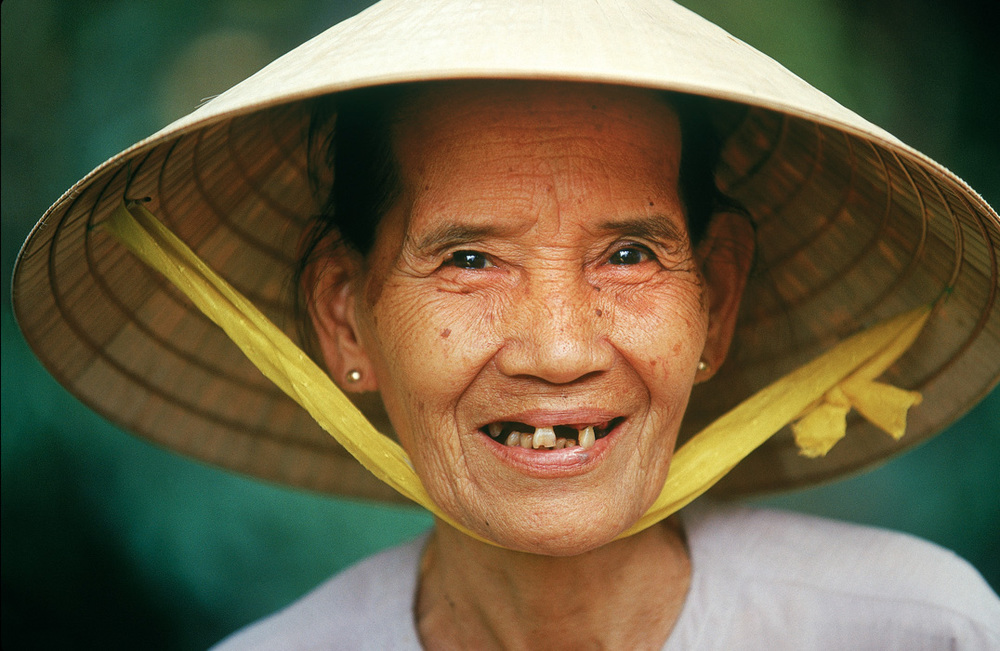 Steve McCurry's work showing up very clearly in the next few portraits of mine. Near Can Tho City, Vietnam