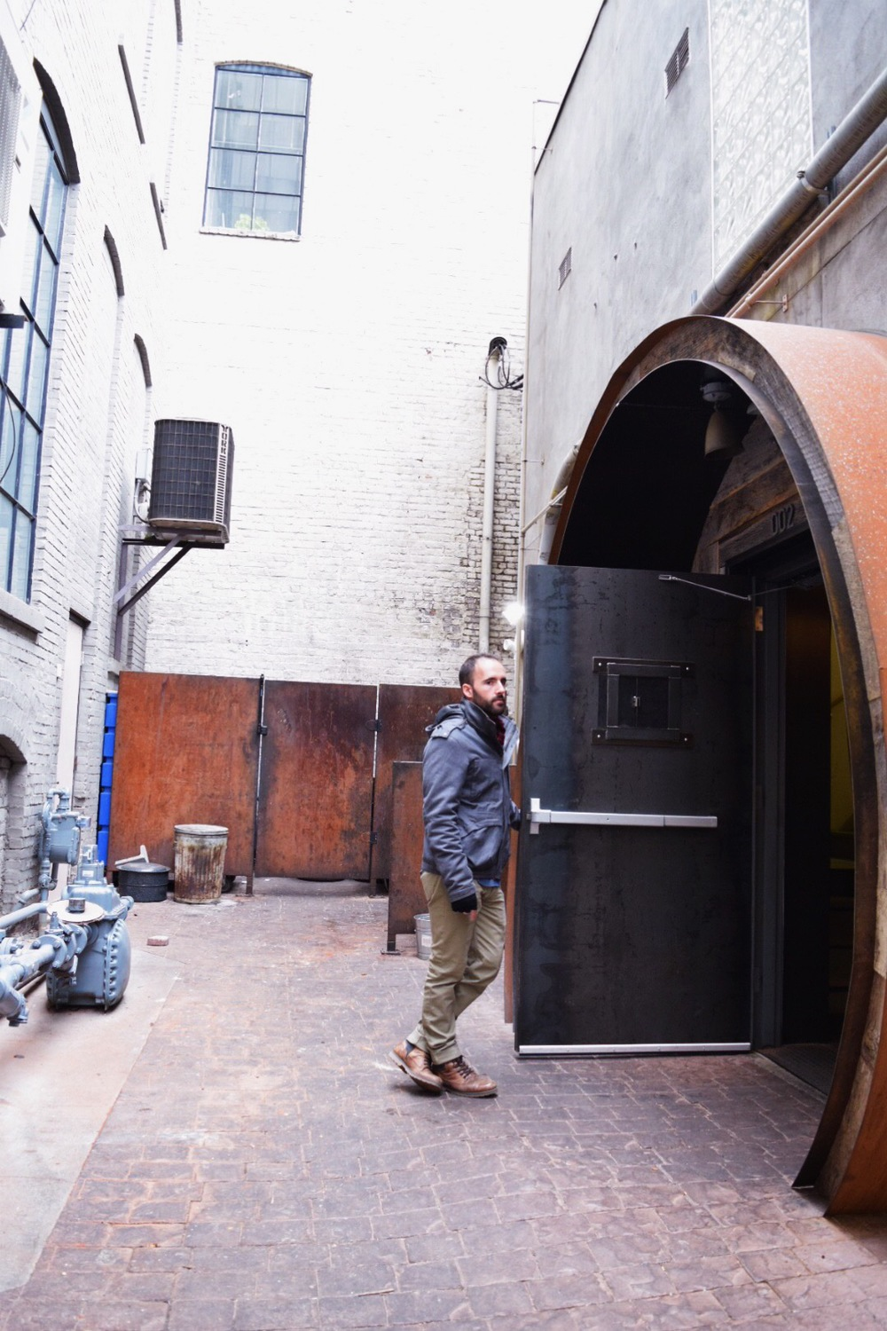 The entrance is right off Patton Ave and takes you down a staircase to the dimly-litbrewery.