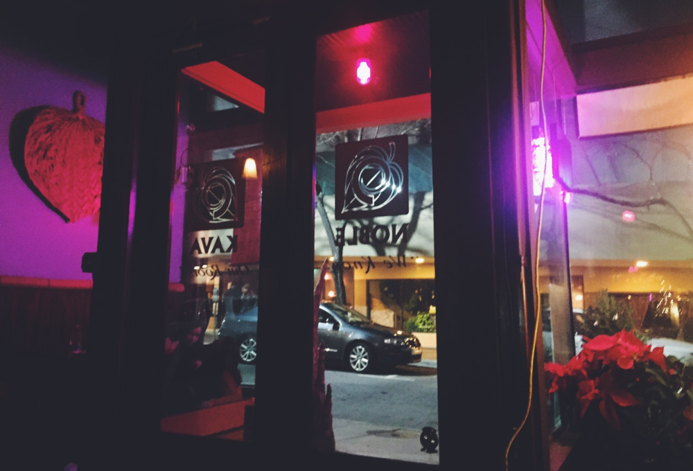 View from inside leisurely sippin' our Kava and looking out into the streets of Downtown Asheville.