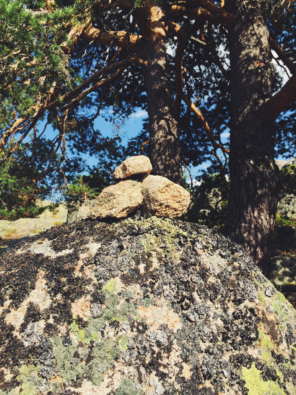 """when travelers separate or must find their way back, they leave a small stack of 3 stones to let them know they're headed in the correct direction. we took it as a good omen to see this. it's the hiker's version of saying, """"you're on the right path."""""""