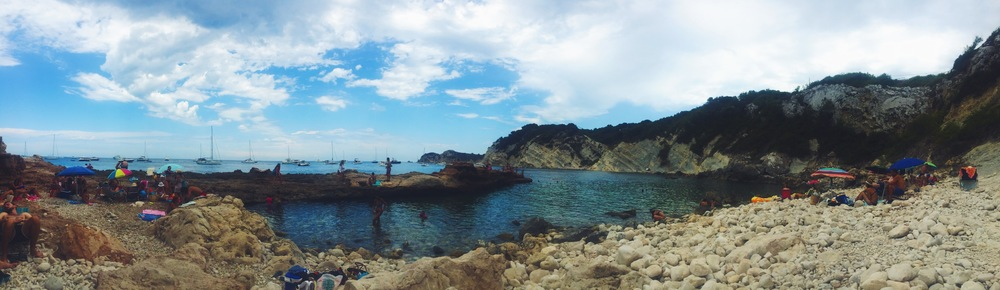 Vacationing in the Spanish Mediterranean. A hidden rock beach at the bottom of a cliff. Hidden travel spots!