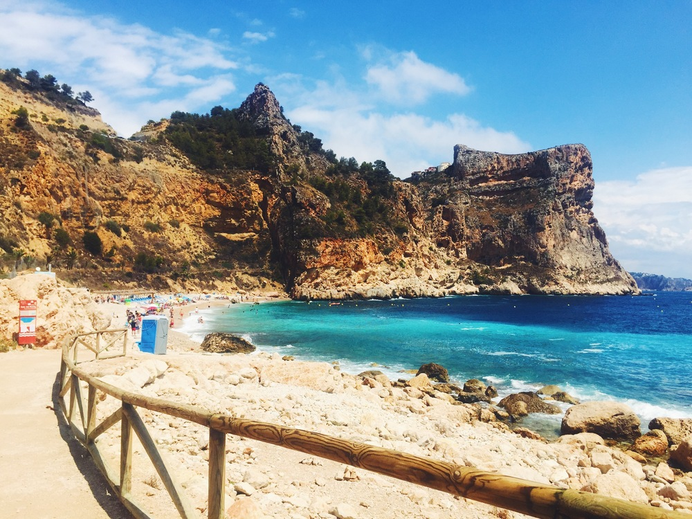 Vacationing in the Spanish Mediterranean. A hidden beach just off the coast, secluded beach fun & tropical drinks.