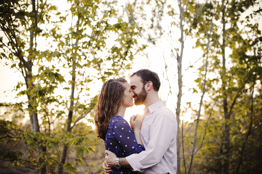kissing at sunset in the woods | Sunglow Photography