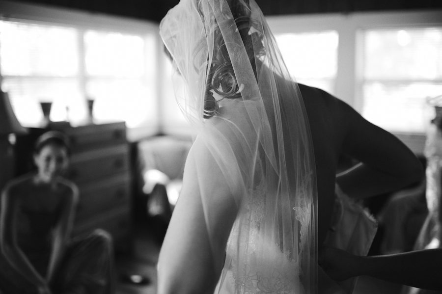 bride lacing up dress