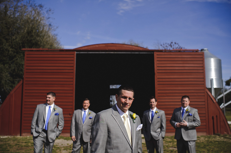groomsmen in front of a barn
