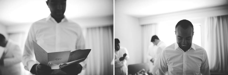 groom getting ready in hotel room for wedding