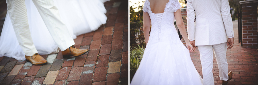 bride and groom walking on brick path