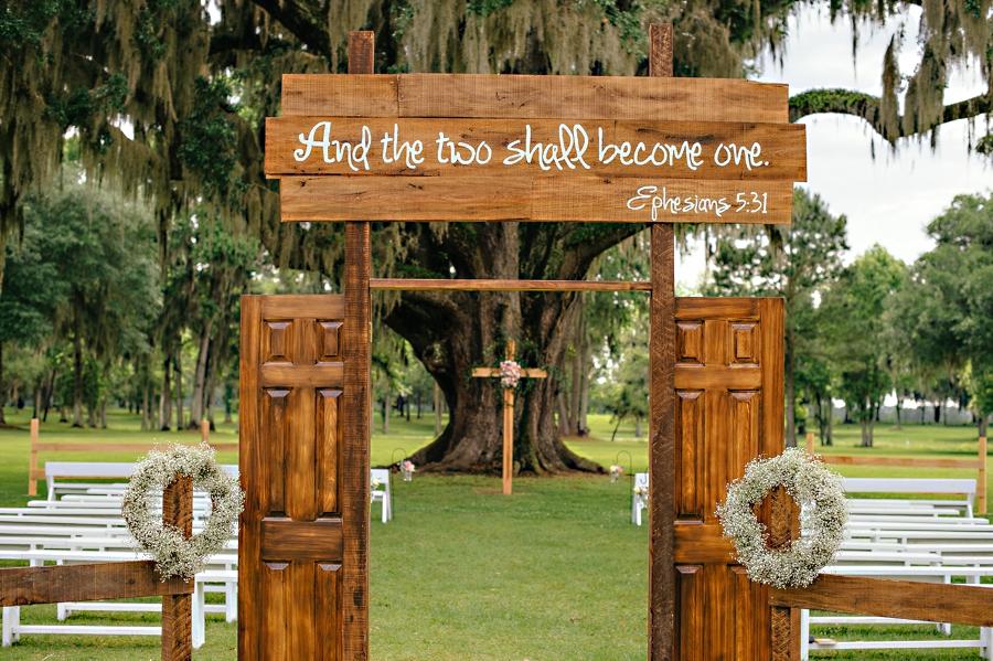 DIY Door at Wedding in an open field under a giant oak tree
