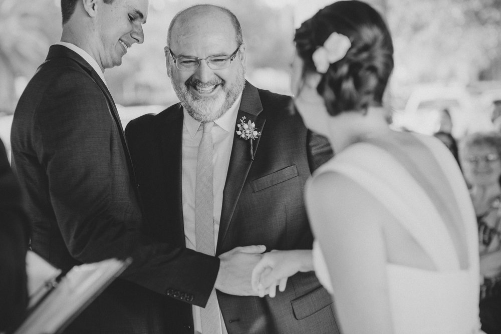 father giving daughter away at wedding