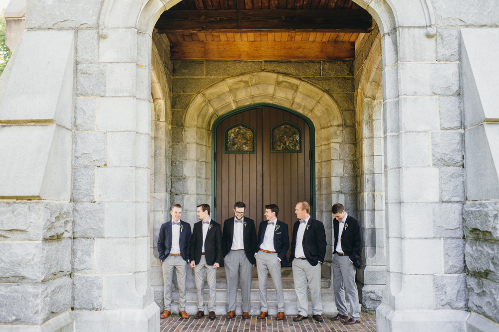 awesome groomsmen outfit, grey pants, blue jacket, purple bow tie, tan shoes, men attire