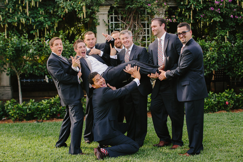 Navy Suit with champagne and plaid tie Groomsmen
