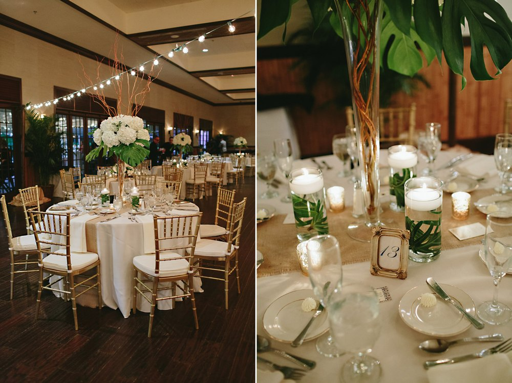 Wedding reception with tall vase hydrangeas and curly willow