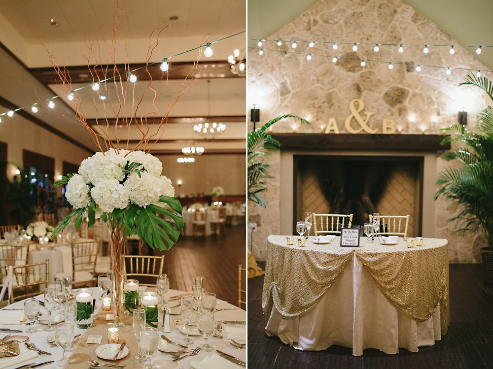 gold and white wedding reception with tall vase hydrangeas and curly willow and indoor market lights