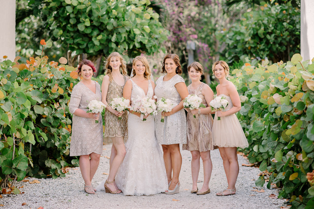 short mismatched gold, silver, and champagne bridesmaids dresses