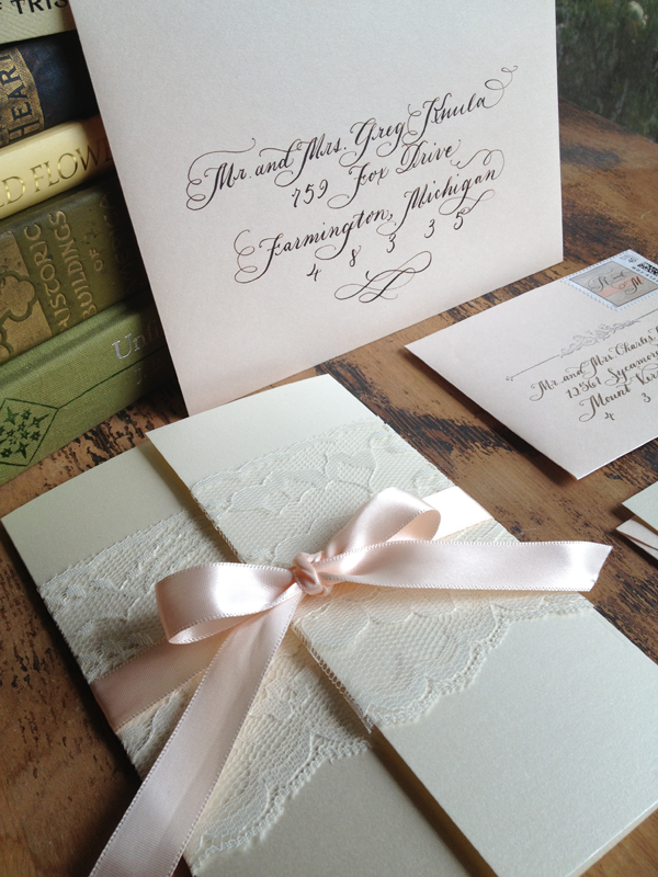blush pink calligraphy wedding invitation