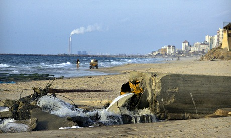 A sewage drain floods into the Mediterranean Sea off the coast of Gaza, in Nuseirat. Photograph: Warrick Page/Getty Images