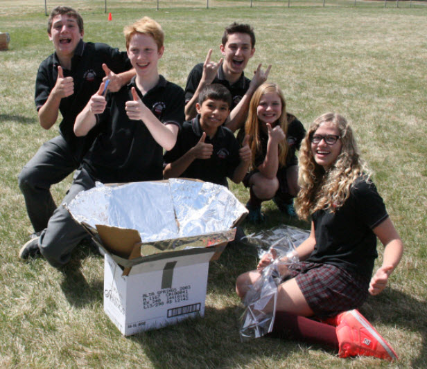Students building a solar oven