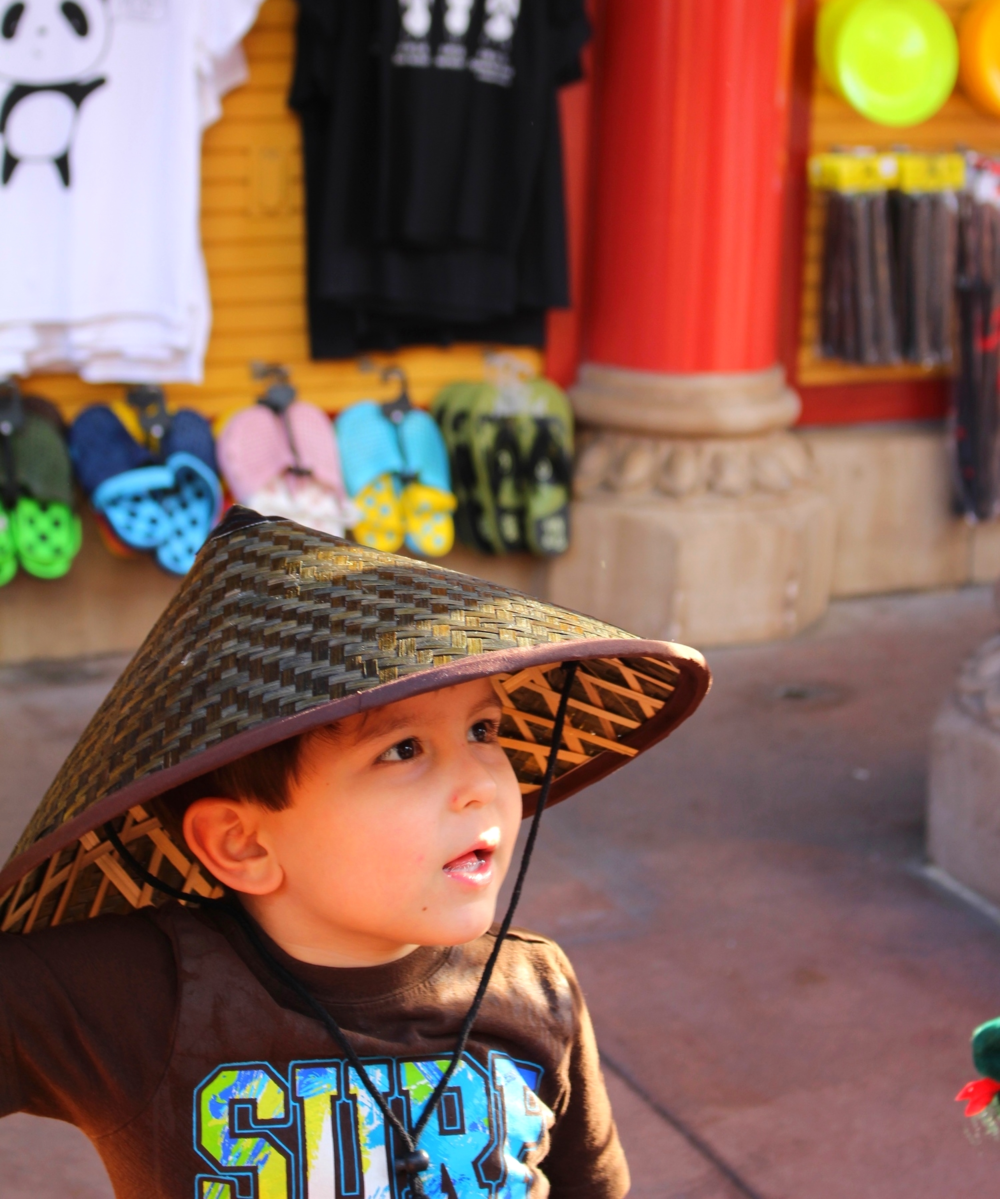 He is rocking this traditional Chinese hat.