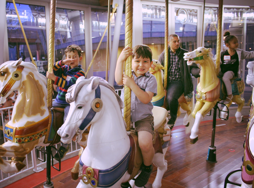 Ah! My boy at the Carousel. He loves the 'caballos'(horses)