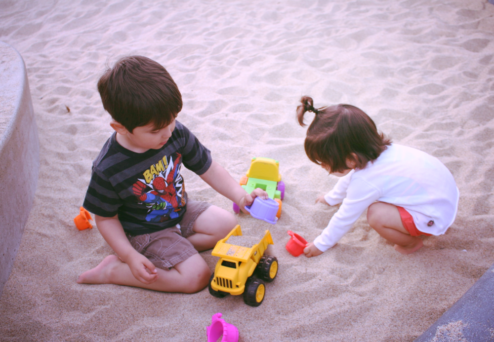 Kids playing in the sand.
